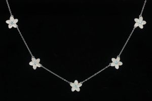 Necklace of five xs plumeria with blue topaz